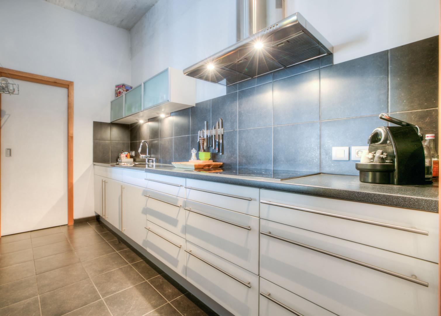 Trendy loft van 140 m2 met groot terras en hoge plafonds